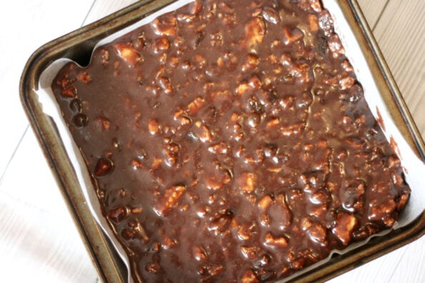 chocolate tiffin in a baking tin before it has chocolate on top