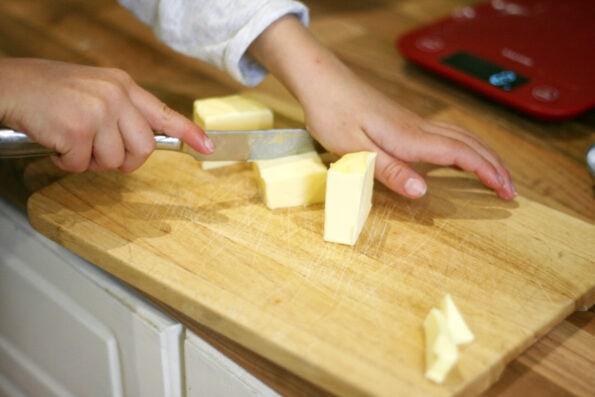child chopping butter