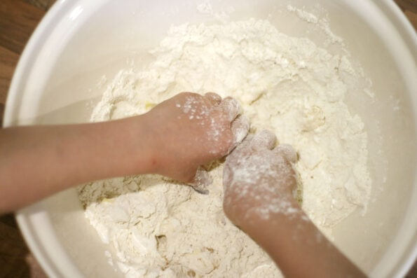 child rubbing in butter and flour