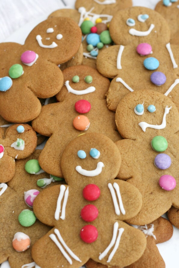 gingerbread men made by kids stacked in a pile