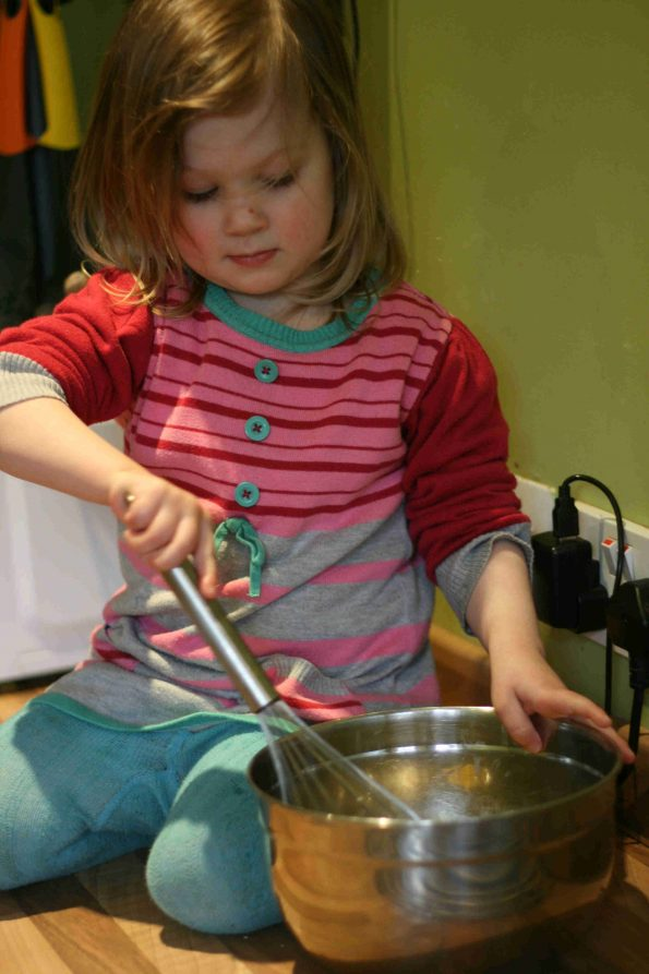 child whisking in a bowl
