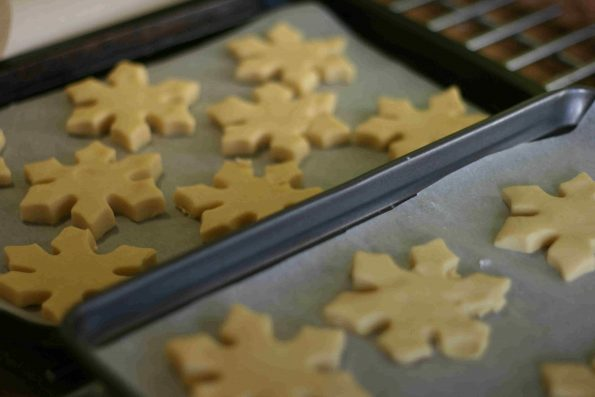 uncooked christmas shortbread on baking trays