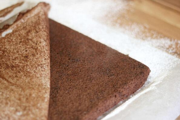 peeling baking paper off the back of a yule log