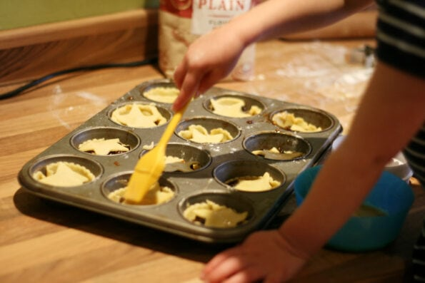 egg washing mince pies.