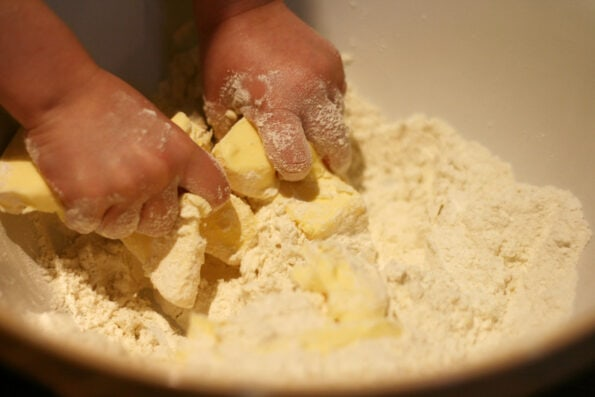 rubbing together butter and flour.
