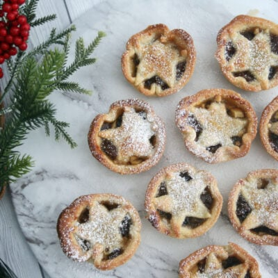 Mince pies on a serving plate.