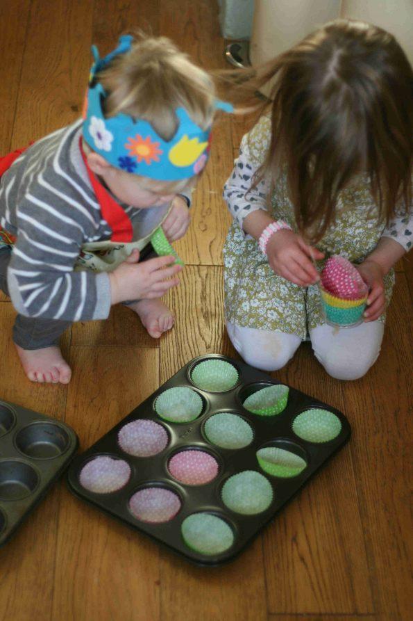 preparing cupcake cases for peaches and cream cupcakes