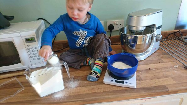 child making a chocolate cheesecake recipe