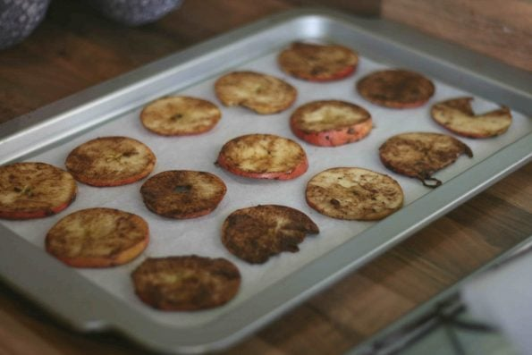 baked apple chips on a baking tray