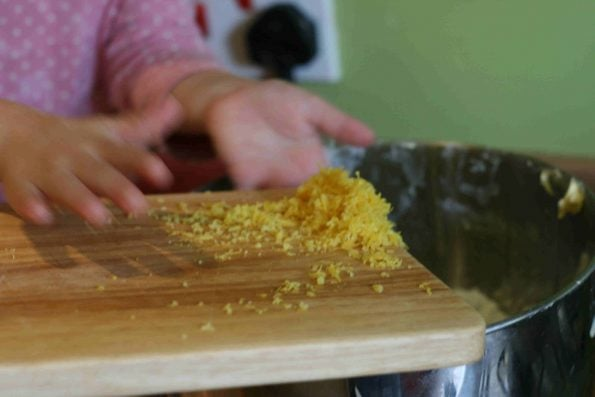 adding lemon zest to a bowl