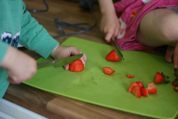 preparing fruit for berry yoghurt parfait