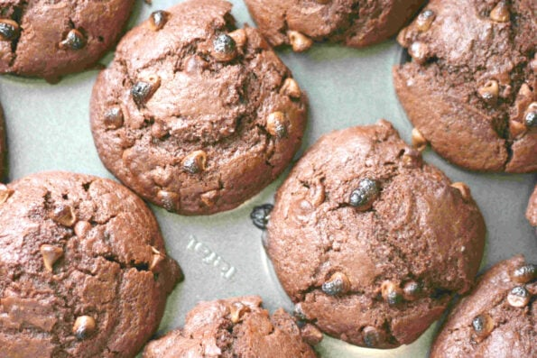 triple chocolate muffins in a baking tin
