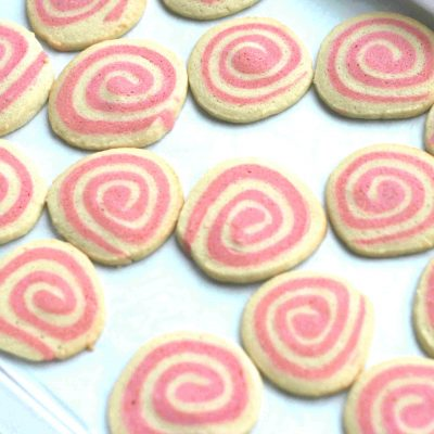 spiral biscuits on a baking tray