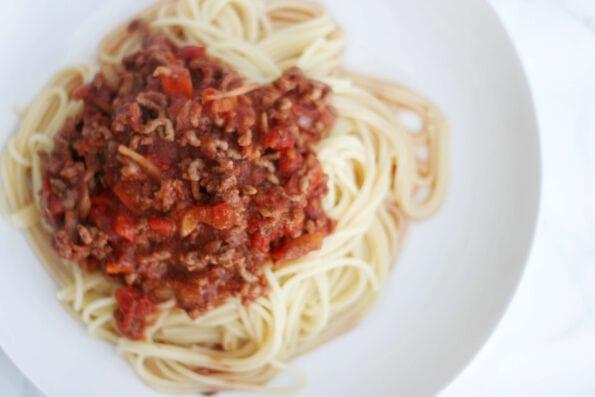 spaghetti bolognese in a white dish