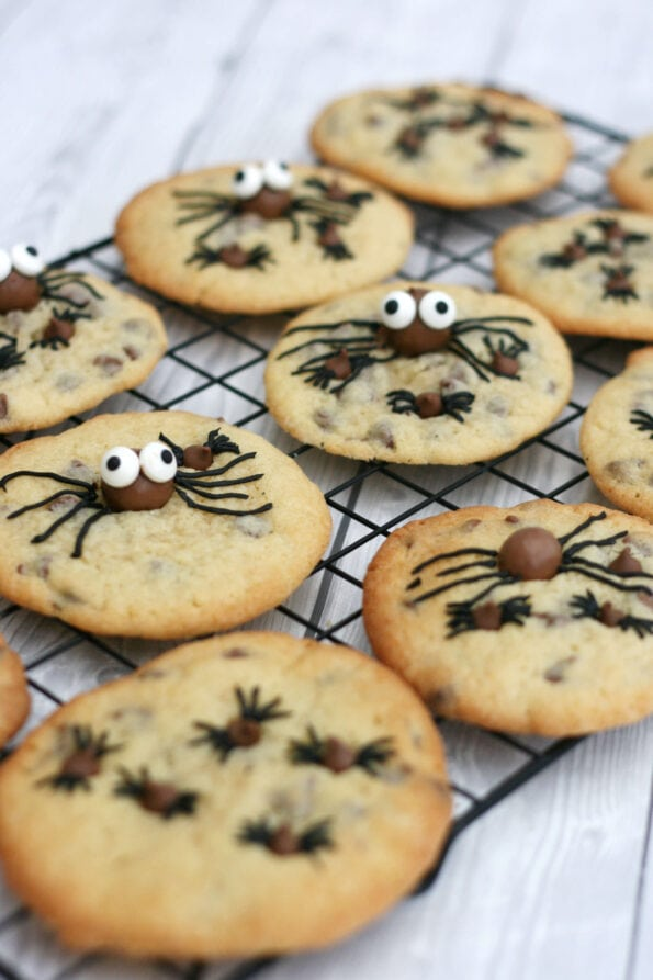 halloween spider cookies on a wire rack