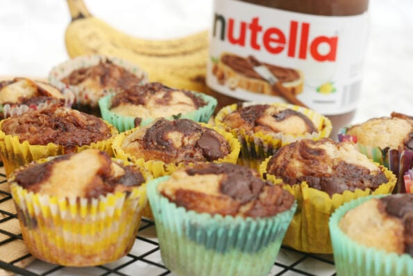 Banana Nutella muffins on a wire rack.