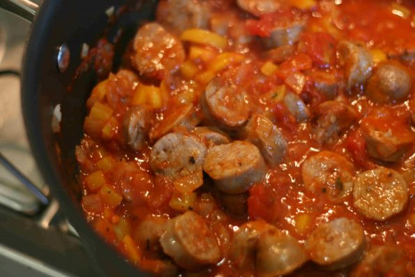 sausages cooking in a tomato sauce