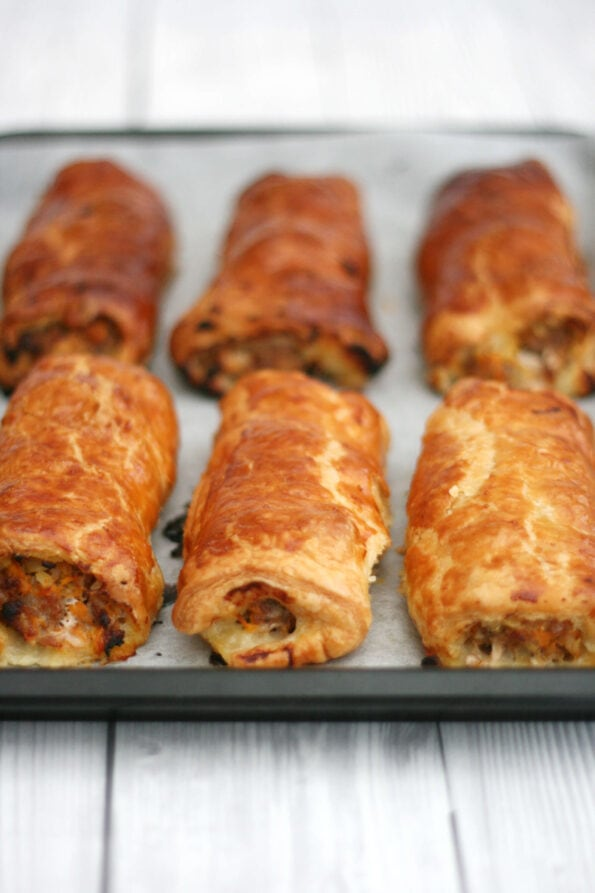 sausage rolls on a baking tray