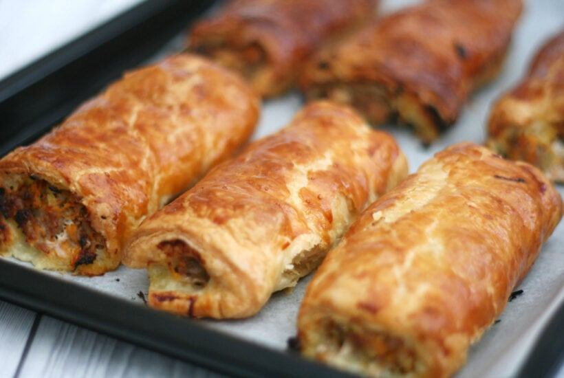 homemade sausage rolls on a baking tray