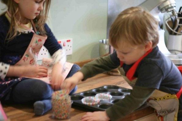 kids making banana and chocolate cupcakes