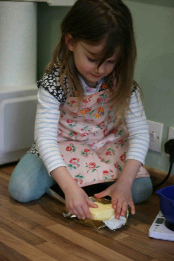 child making mars bar slice