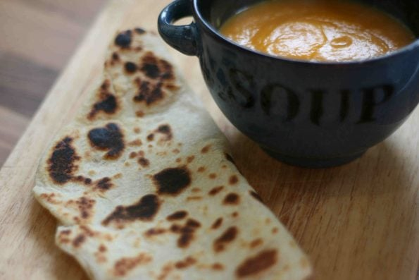 flat bread next to a bowl of soup