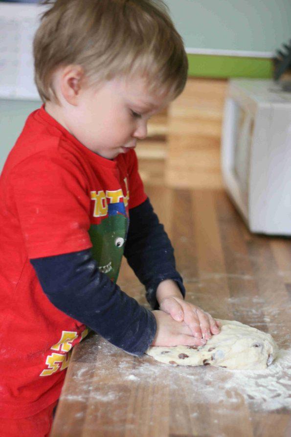 child making fruit scones