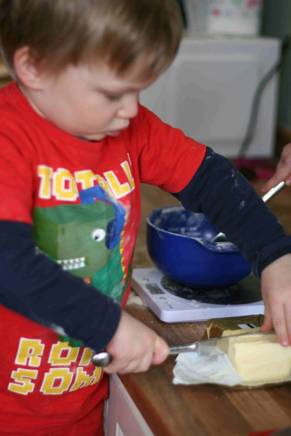 child cutting butter