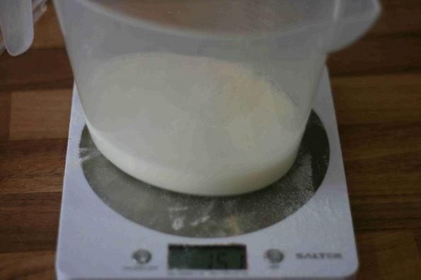 measuring milk into a jug