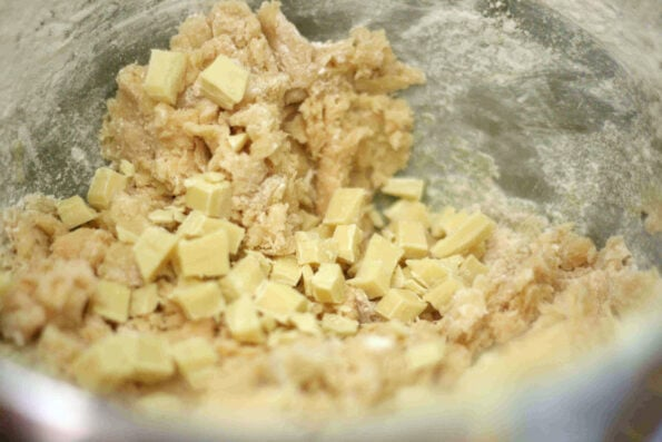 white chocolate being added to custard biscuits