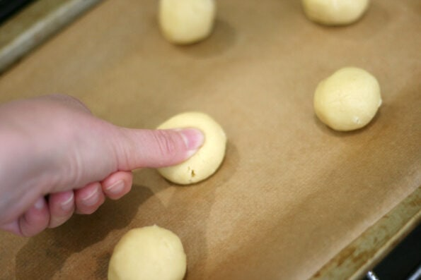 pressing the centre of thumbprint cookies