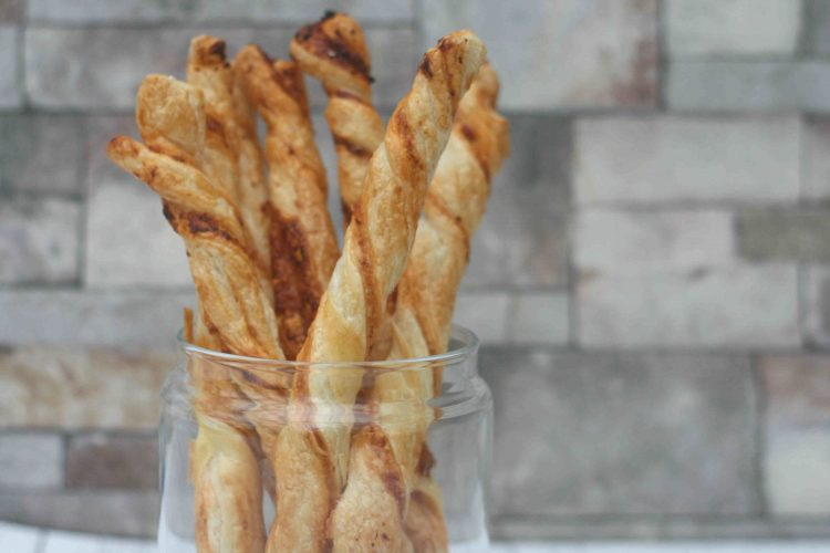 Cheese twists upright in a jar