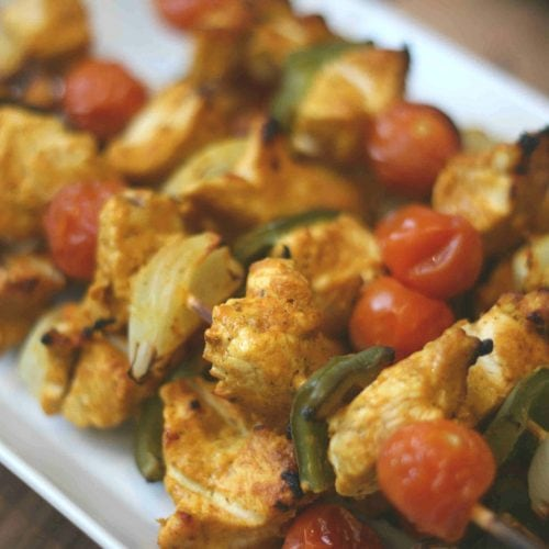 close up of chicken skewers