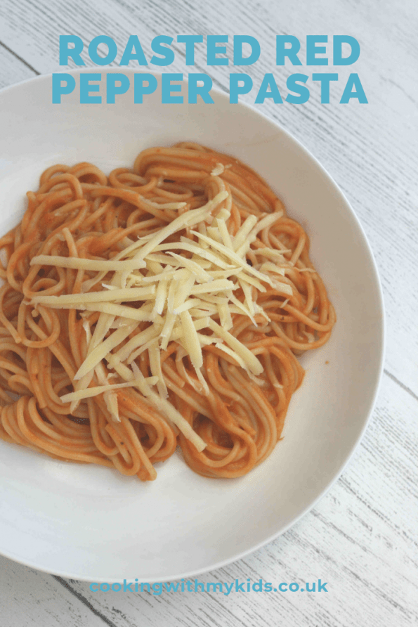 roasted red pepper pasta in a white bowl