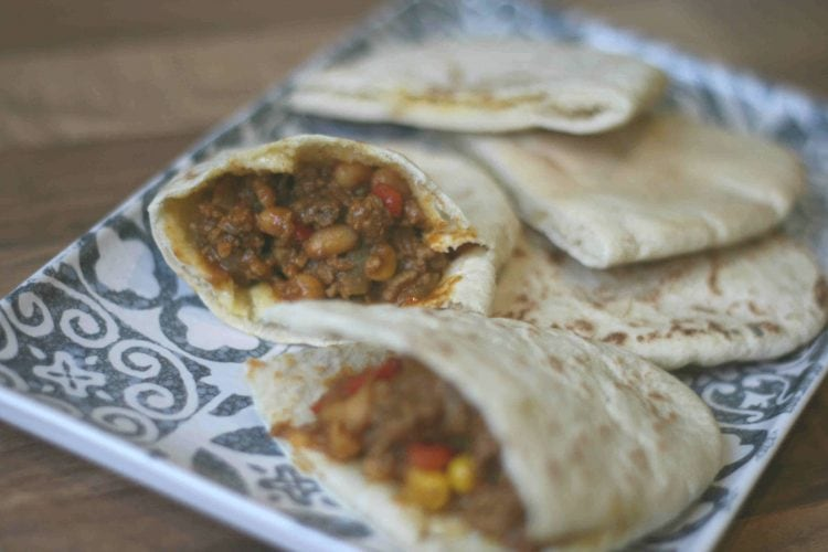curried mince stuffed into pita bread on a plate