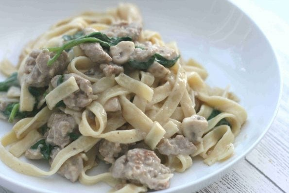 creamy sausage pasta on a plate