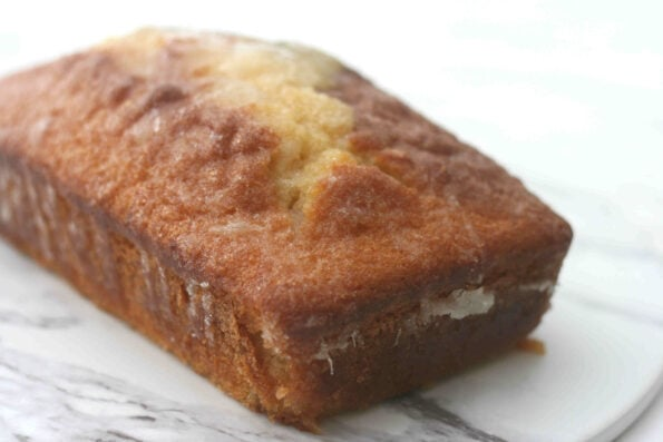 Mary Berry's lemon drizzle cake on a serving platter