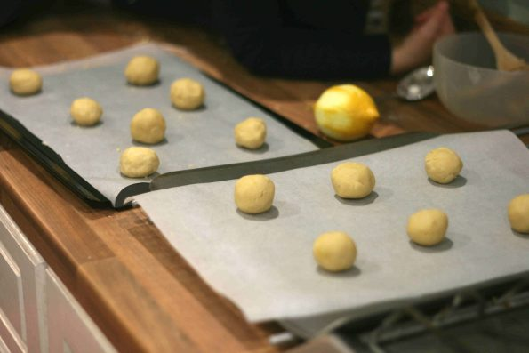 lemon biscuits on baking trays waiting to be baked