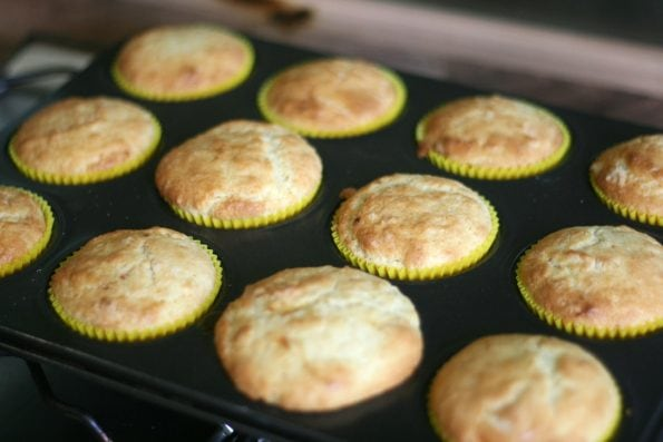 lemon curd muffins in a baking tin