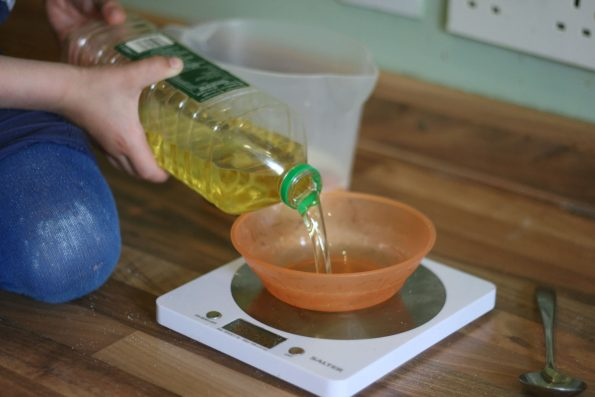 pouring oil into a bowl