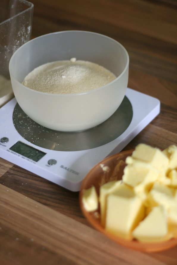 measuring butter and sugar