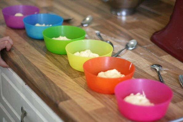 cupcake batter in small coloured bowls