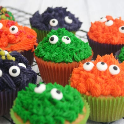 Halloween monster cupcakes on a wire rack