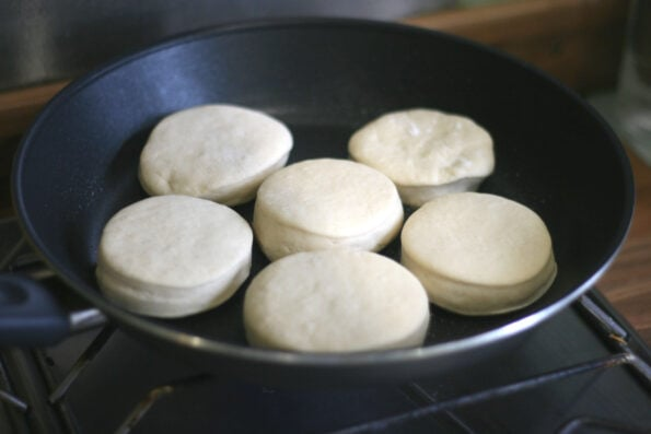 cooking english muffins in a pan