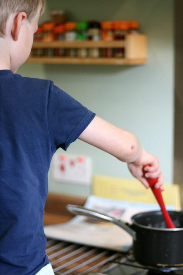 child stirring creme patissiere