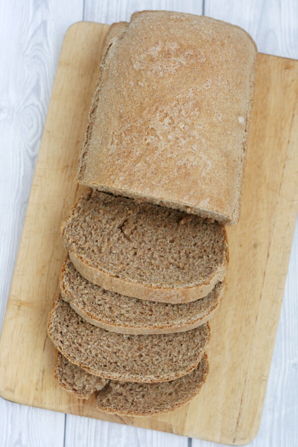 sliced brown bread on a wooden board.