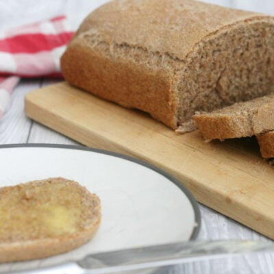 brown bread sliced on a plate.