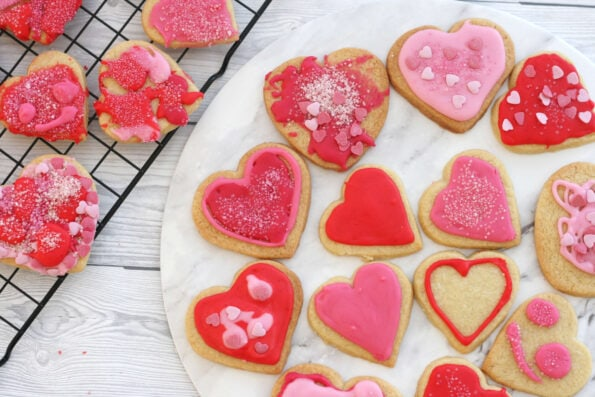 heart cookies on a wire rack and serving plate