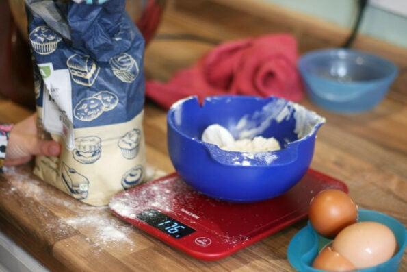 measuring flour into a bowl