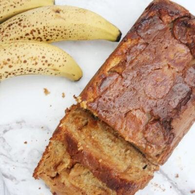 caramel banana bread sliced on a serving plate
